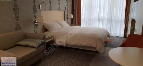 A bed or beds in a room at Istanbul Resort Hilltown