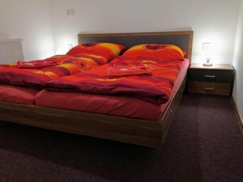 Кровать или кровати в номере Dj-penzion