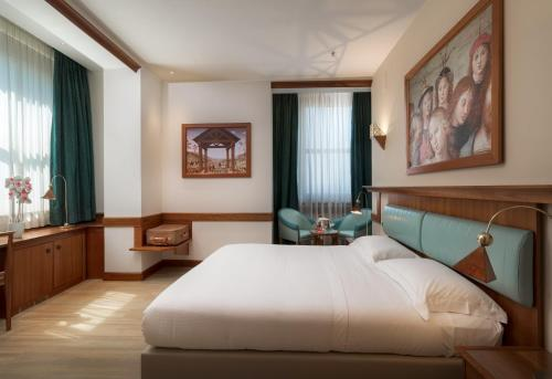 A bed or beds in a room at Sangallo Palace