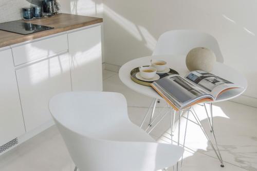 A kitchen or kitchenette at Centro Design Apartments - Półwiejska