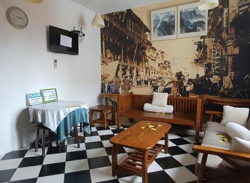 Ein Restaurant oder anderes Speiselokal in der Unterkunft Vintage Inn Boutique Capsule @ Little India
