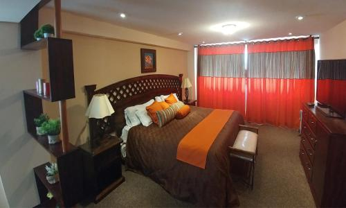 A bed or beds in a room at Vita Hoteles Colca