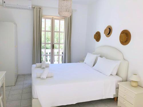 Ένα ή περισσότερα κρεβάτια σε δωμάτιο στο Πέτρινο