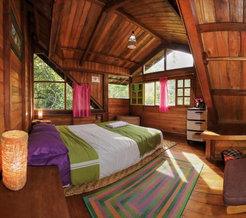 A bed or beds in a room at Mindo Eco Chalet with Natural Pool and Waterfalls