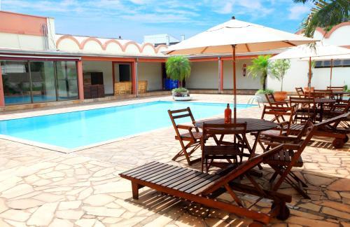 The swimming pool at or near Hotel Fernandão