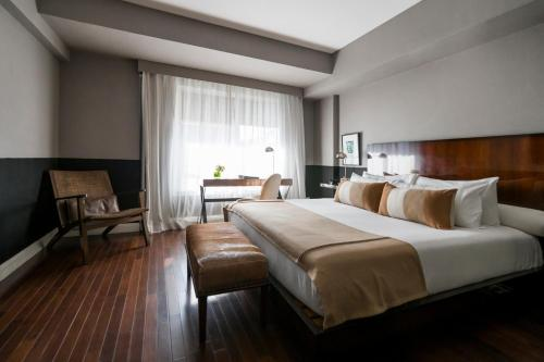A bed or beds in a room at CasaSur Recoleta
