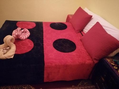 Ein Bett oder Betten in einem Zimmer der Unterkunft Dar Atlas