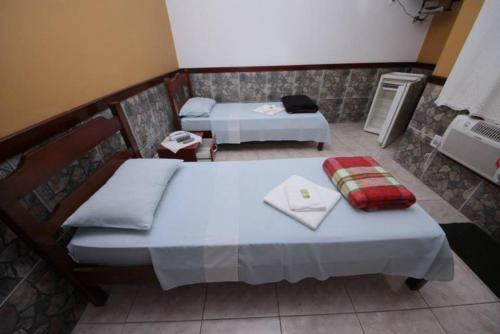 A bed or beds in a room at Pousada H&D