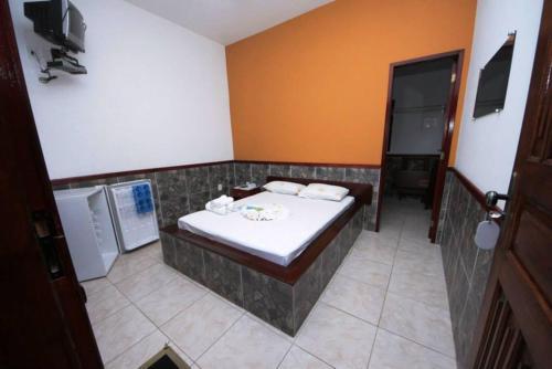 A bathroom at Pousada H&D