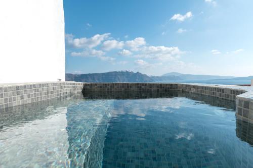 The swimming pool at or near Caldera Premium Villas