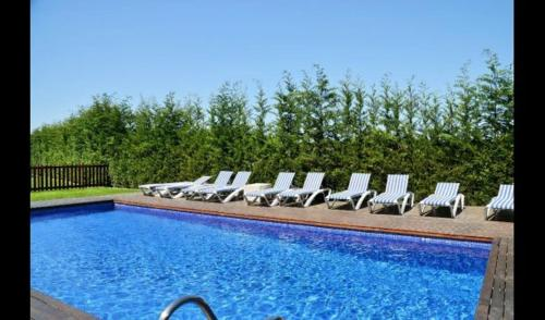 The swimming pool at or near Vilobi d'Onyar Villa Sleeps 13 with Pool and Air Con