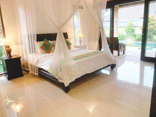 Letto o letti in una camera di Siwaya Villa