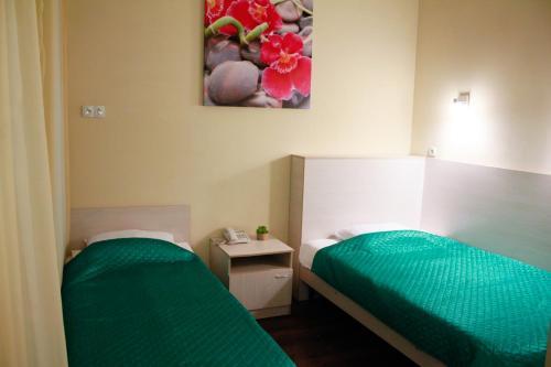 Кровать или кровати в номере Рапсодия