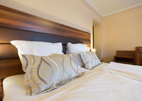 Łóżko lub łóżka w pokoju w obiekcie Beskidian