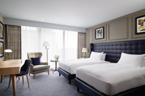 A bed or beds in a room at The Grand, York