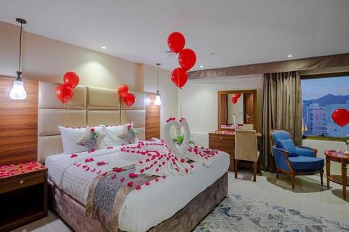 Cama ou camas em um quarto em Rose Al Medina