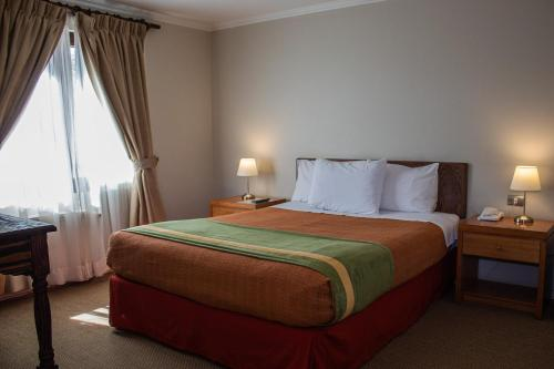 A bed or beds in a room at Hotel Diego de Almagro San Pedro De Atacama