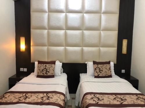 Cama ou camas em um quarto em Rayatna For Furnished Apartments 3
