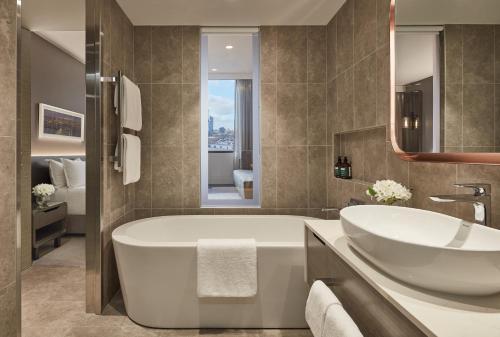 A bathroom at Crowne Plaza Melbourne, an IHG Hotel