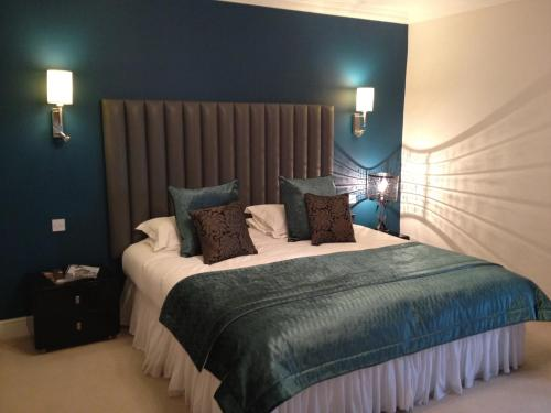 A bed or beds in a room at Fishmore Hall Hotel and Boutique Spa