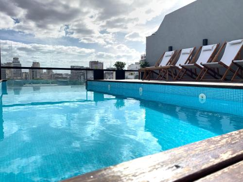 The swimming pool at or near AQ Tailored Suites