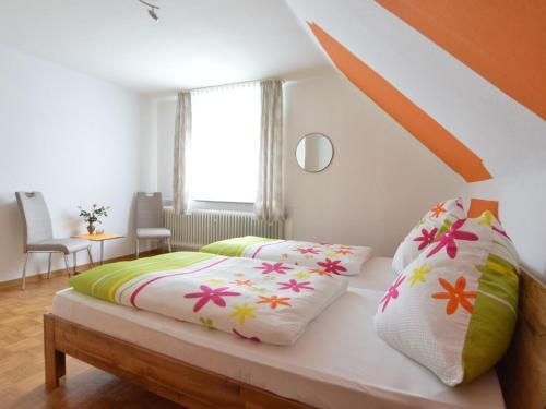 Ein Bett oder Betten in einem Zimmer der Unterkunft Cozy Holiday Home in Tettscheid with Private Garden