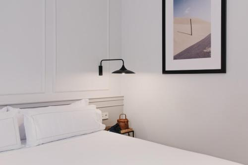 A bed or beds in a room at Helen Berger Boutique Hotel