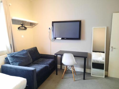 A television and/or entertainment center at Addenro Apartments