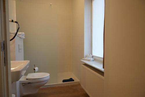 Ванная комната в Focus Hotel