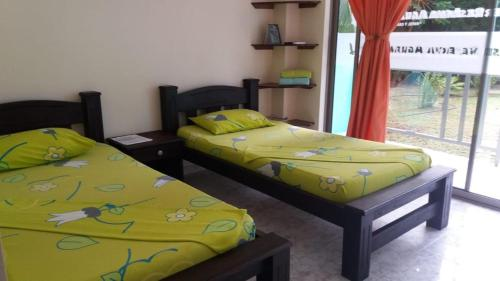 A bed or beds in a room at Hotel Reserva Aguamarina