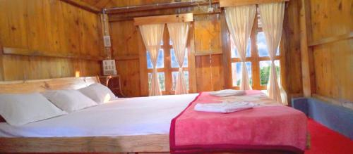 A bed or beds in a room at Kanoka Village Resort