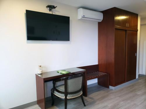 A television and/or entertainment centre at Hotel Lexus