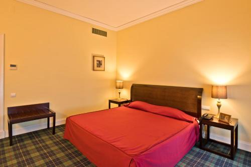 Uma cama ou camas num quarto em Golden Tulip Caramulo Hotel & Spa