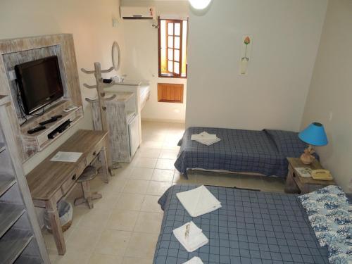 Cama ou camas em um quarto em Pousada Mata Atlantica Juquehy