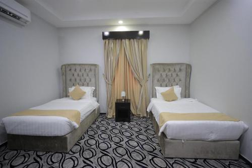 Cama ou camas em um quarto em لؤلؤة جازان