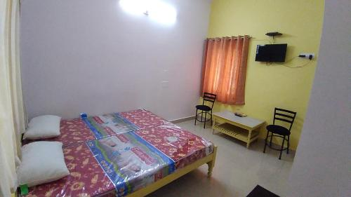 A bed or beds in a room at Bimala Hotel