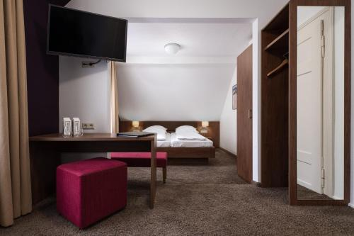 A bed or beds in a room at Boutique Hotel Societe