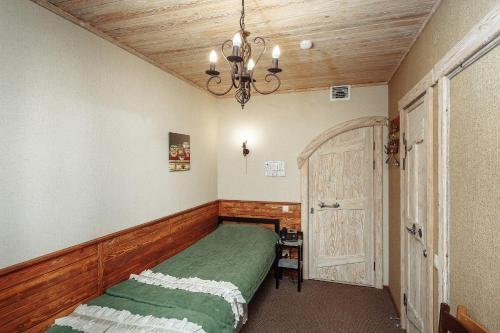 Кровать или кровати в номере Отель 3 Гнома