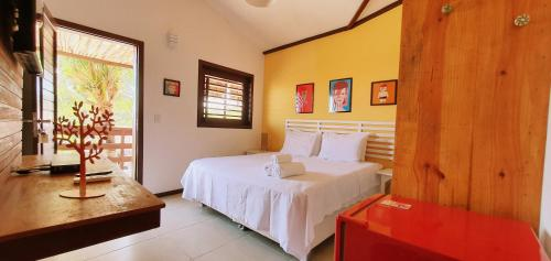 A bed or beds in a room at Pousada La Vie Jeri