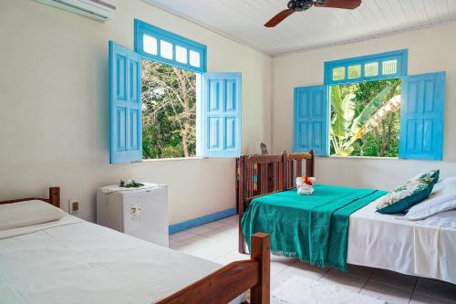 Cama ou camas em um quarto em Ganga Zumba Pousada & Hostel