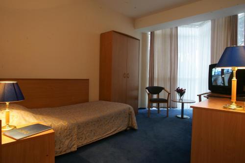 Кровать или кровати в номере Морская Звезда