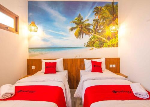 A bed or beds in a room at RedDoorz near Nusa Dua Beach