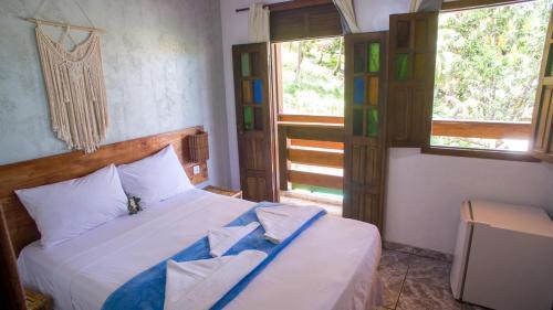 Cama ou camas em um quarto em Pousada Bicho Preguiça
