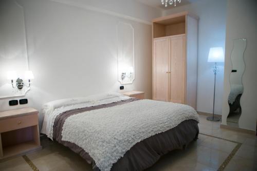 Letto o letti in una camera di Hotel Miramare