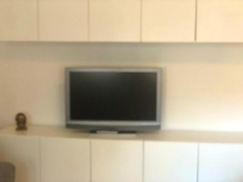 A television and/or entertainment center at Apartment with one bedroom in Terni with wonderful city view