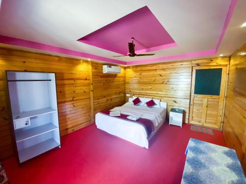 A bed or beds in a room at Om Sai Beach Huts
