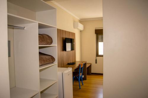 A kitchen or kitchenette at Hotel Letto Caxias