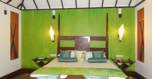 A bed or beds in a room at Taj Kumarakom Resort and Spa Kerala
