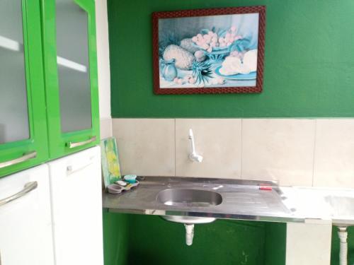 A kitchen or kitchenette at Kitnet Próxima ao Aeroporto