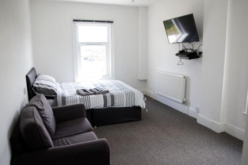 A bed or beds in a room at Bursar Street 21